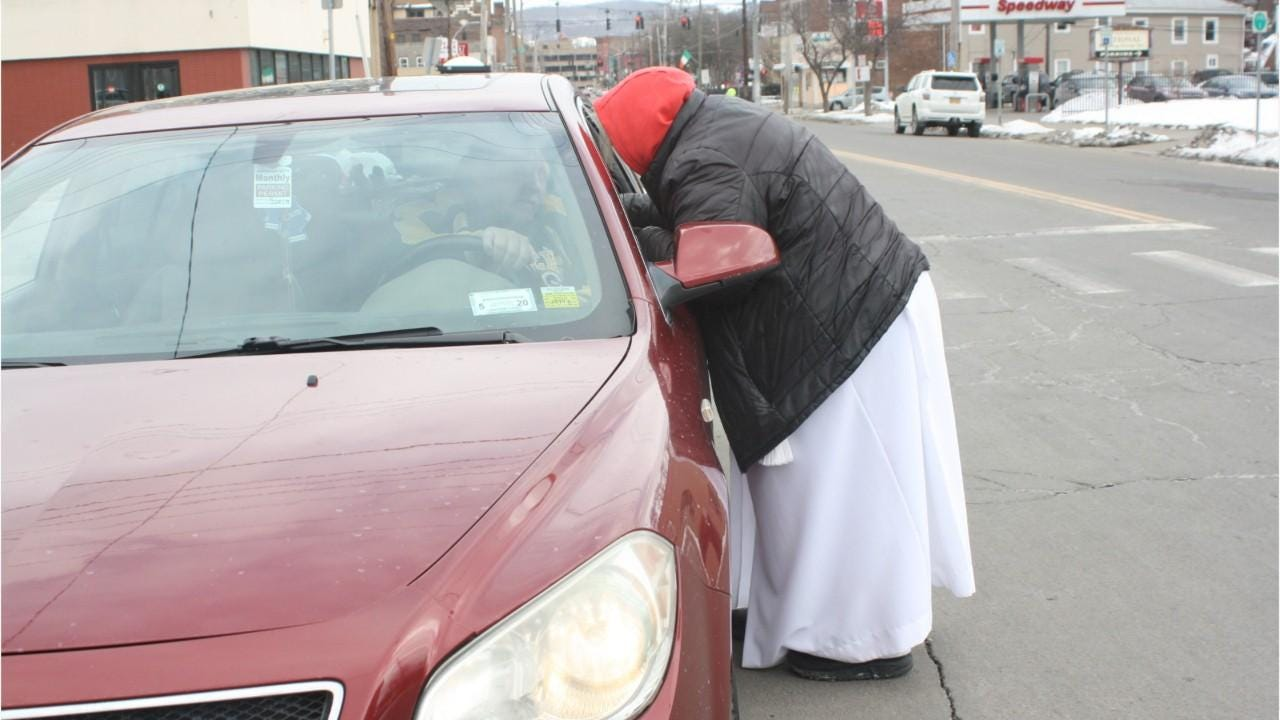 Clergy from Redeemer Lutheran in Binghamton provided ashes to passersby on the street for Ash Wednesday.Clergy from Redeemer Lutheran in Binghamton provided ashes to passersby on the street for Ash Wednesday.