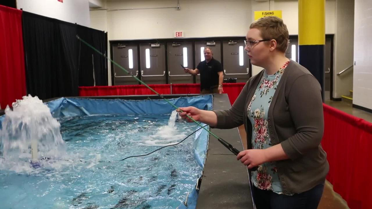 Argus Leader reporter Makenzie Huber goes fishing at the live fish pond at Sioux Empire Sportsmen's Show, Thursday, March 7, 2019 in Sioux Falls, S.D.