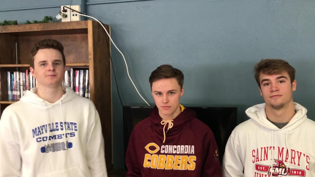 St. Cloud Cathedral's Nick Schaefer (Mayville State), Jackson Jangula (Concordia-Moorhead) and Sam Schneider (St. Mary's) talk after signing Thursday.