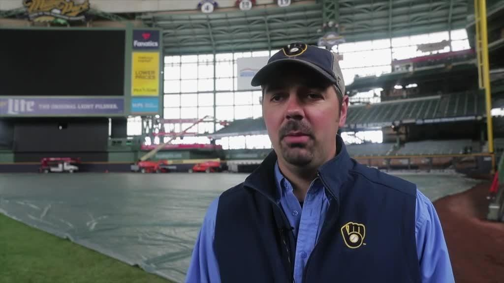 Tarp comes off the field at Miller Park