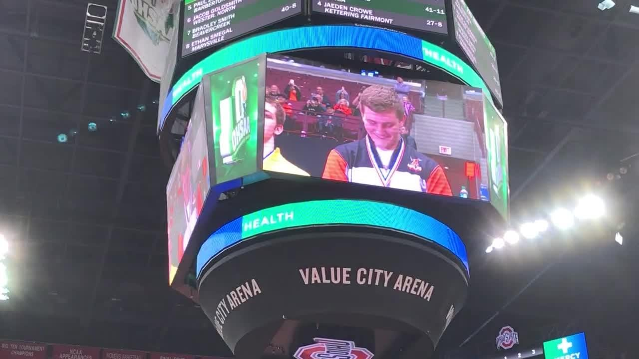 The Schottenstein Center video board shows Ashland senior Josh Bever receive his DI 220 title medal after scoring winning takedown with 12 secs left.