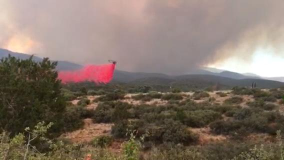 Watch fire crews drop retardant on the Goodwin Fire