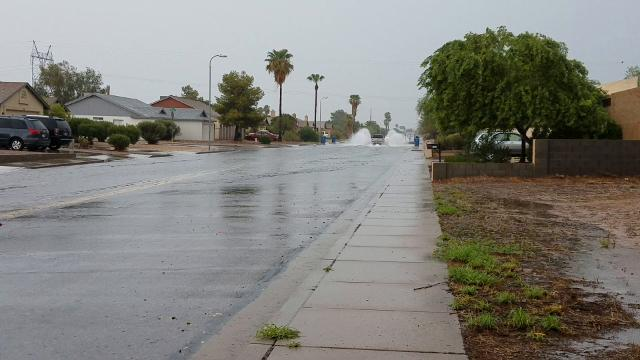 Rain soaks Mesa neighborhood