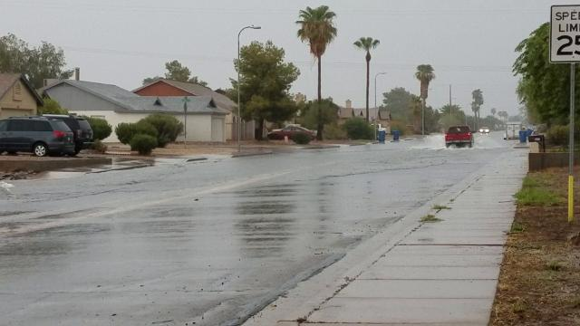 Rain and rushing water in east Mesa