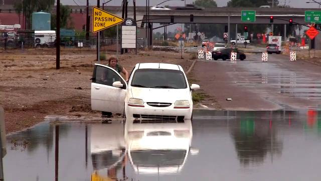 Driver gets stuck on flooded street