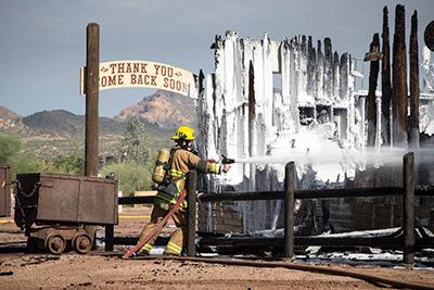 Superstition Fire and Medical crews work to put out the fire that destroyed the Mining Camp Restaurant on July 25, 2017. Mark Henle/azcentral.com