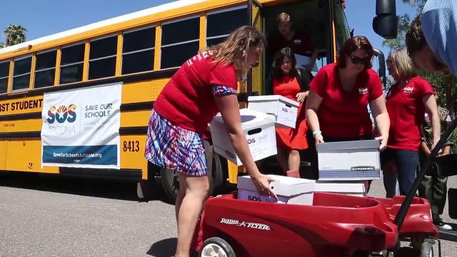 Group delivers signatures to halt school-voucher expansion
