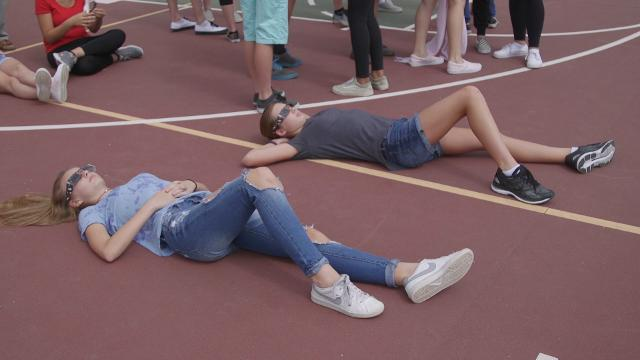 Students at Canyon Springs school watch the solar eclipse