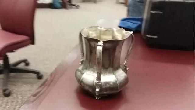 An ASU archivist brought the 118-year-old cup back from Tucson on Dec. 1, 2017.