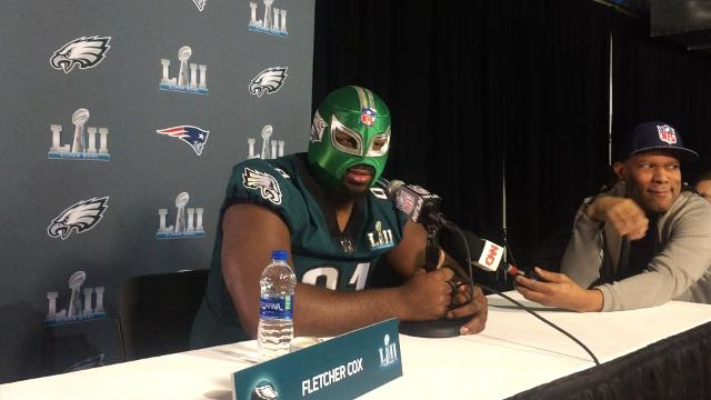 Eagles defensive lineman Fletcher Cox dons a Lucha Libre mask when meeting with the media before Super Bowl LII in Minneapolis.
