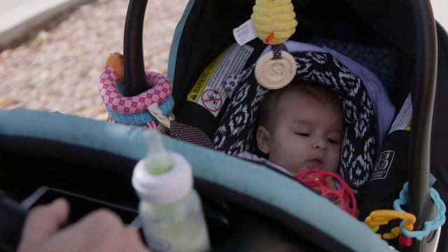 Through a revised Department of Child Safety policy, Breanna Donaldson, a recovering heroin addict, gets to keep her baby at home. David Wallace/The Republic