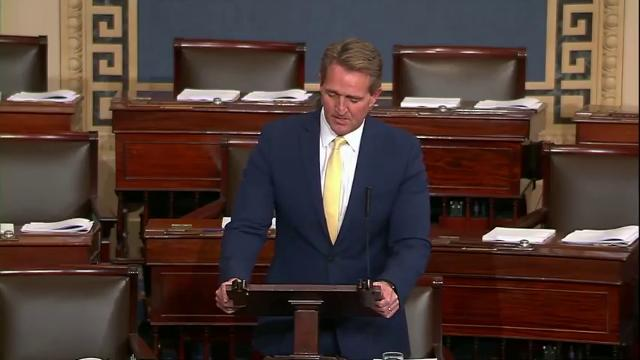 "Sen. Jeff Flake, R-Ariz., blasts President Donald Trump from the Senate floor on Feb. 6, 2018, for joking that Democrats who didn't stand and applaud during his State of the Union speech were ""treasonous."" U.S. Senate"