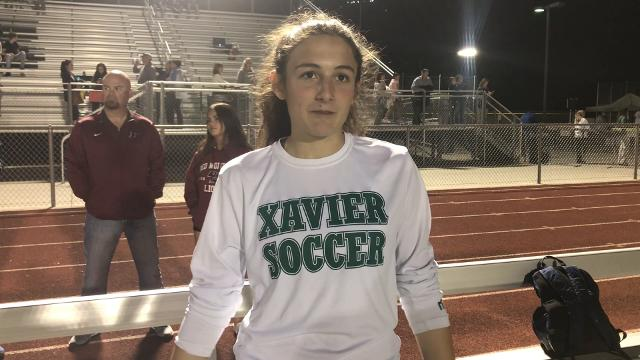 Xavier goalie Kinsey Ehmann talks after a win to move into the state final.