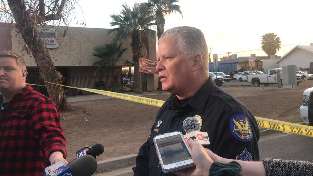 "Phoenix police Sgt. Alan Pfohl said three men were dead and the suspect is in ""extremely critical condition"" after he engaged officers in gunfire outside his west Phoenix home. BrieAnna Frank/azcentral.com"