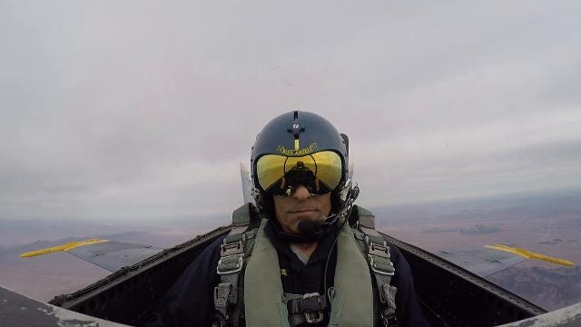 ASU football coach Herman Edwards rides with the Blue Angels.