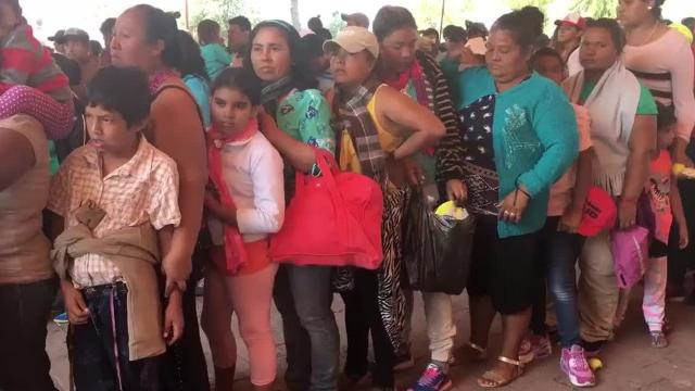 Migrants gather inside a church in Puebla, Mexico
