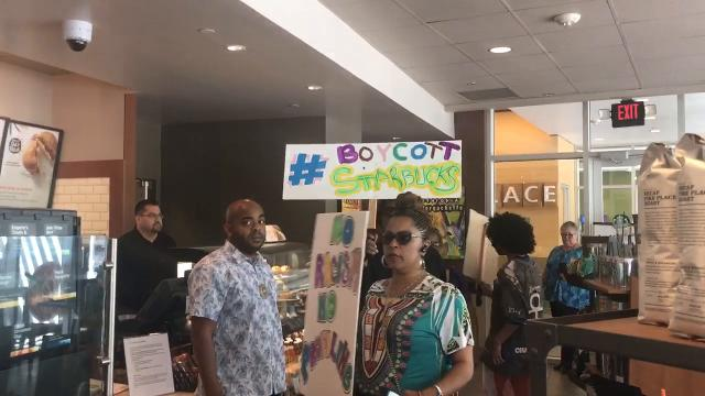 The small group of protesters entered several downtown Phoenix Starbucks locations on April 21, accusing the company of being racist following the arrest of two black men at a Philadelphia store.