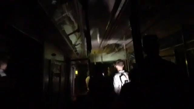 A subway car derailed in Manhattan on Tuesday morning and a passenger captured the seemingly calm reactions of riders hopping off the train.