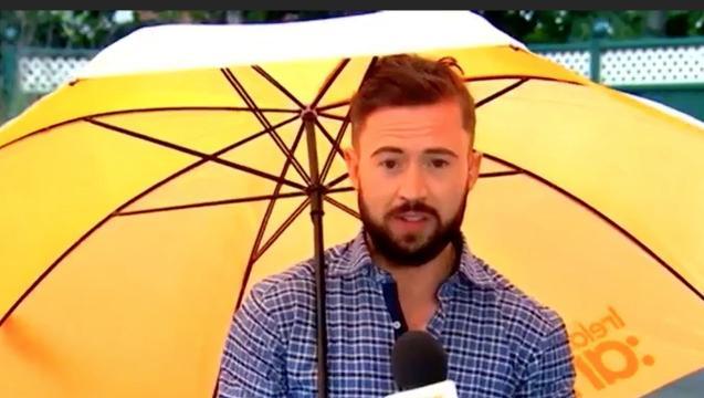 Umbrella Carries Away Weatherman