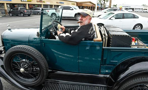 "USA TODAY's Chris Woodyard talks to Larry ""Cigar Larry"" McCullah about his 1928 Ford Model A/R at a car show in Huntington Beach, Calif."