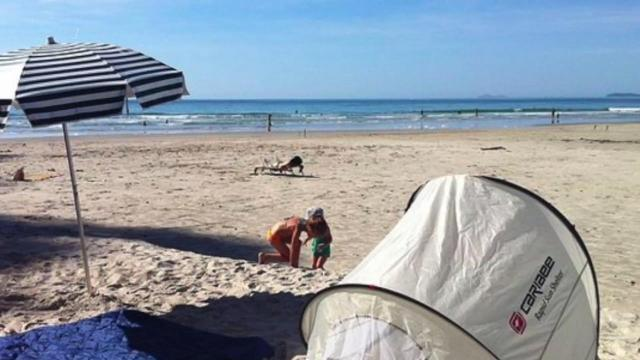 One city is trying to crack down on those annoying beach tents