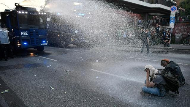 Police unleash water cannons after G20 protests get violent