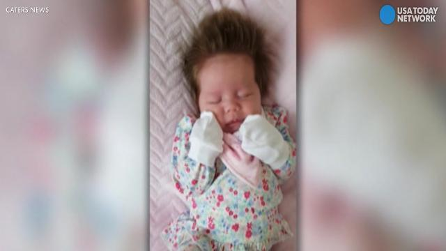 This newborn has more hair than all of us
