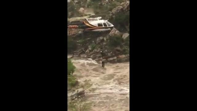 Raw: Chopper Lifts Flood Stranded Hikers To Safety