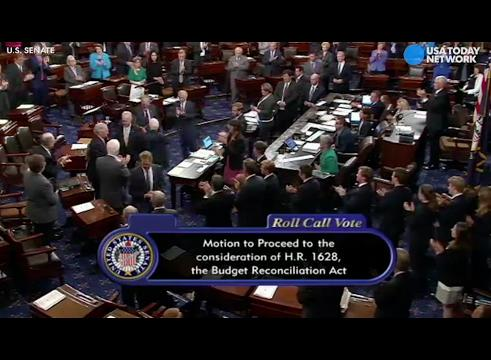 John McCain gets standing ovation on Senate floor