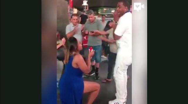 Wife surprises husband with proposal in Times Square