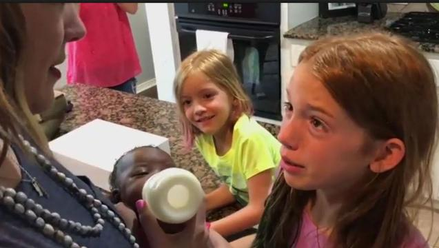 Texas couple surprise daughters with new sister