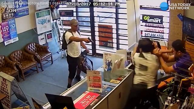 Camera captures store clerks fighting off armed robbers
