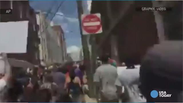 Video shows car plow into Charlottesville crowd