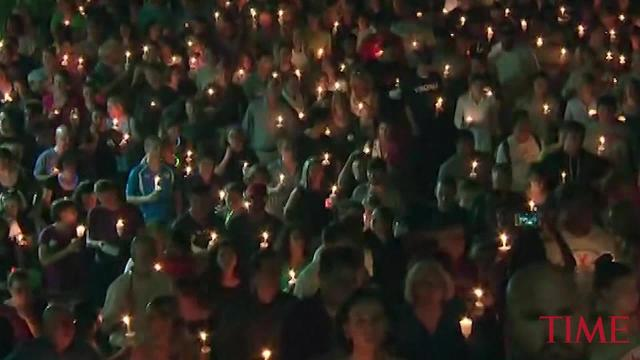 Hundreds of people gathered at the University of Virginia in Charlottesville for a vigil at the scene of Saturday's violence and to pay tribute to Heather Heyer.