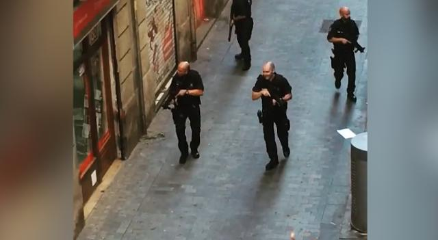 Police search Barcelona streets following van attack