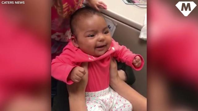 Baby's face lights up when hearing mom for first time