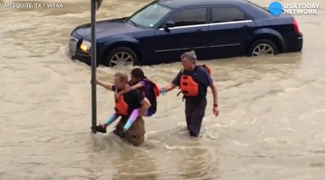 On their backs: Rescuers save child from rising waters