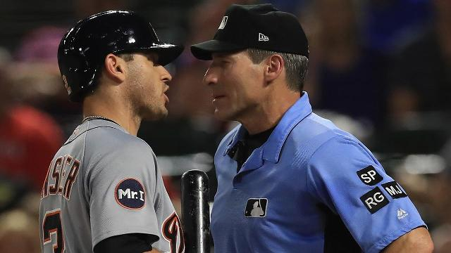 MLB umpires wear wristbands to protest  abusive  treatment a3cd23e77