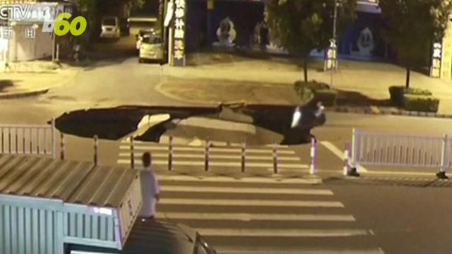 Man on scooter falls into massive sinkhole because he was on phone