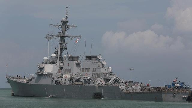Divers discover remains after the USS McCain crash