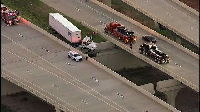 18-wheeler truck dangles off Texas highway