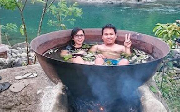 You can soak in a hot tub over an open fire in the Philippines