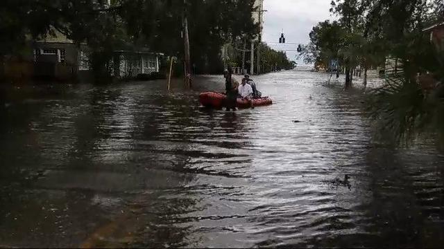 Rescue crews battle record Jacksonville flooding