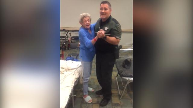 Deputy calms woman in hurricane shelter with spontaneous dance