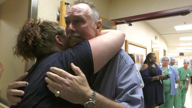 Heart attack survivor hugs doctors who kept him alive