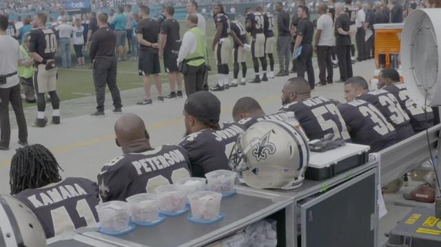 Group of Saints Players Sit During National Anthem