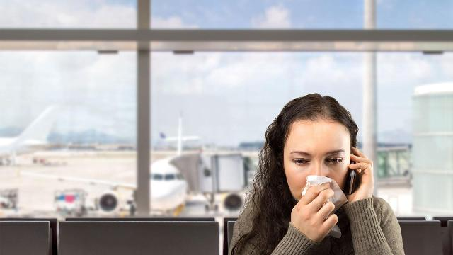 Ever wonder why you always get sick when flying?