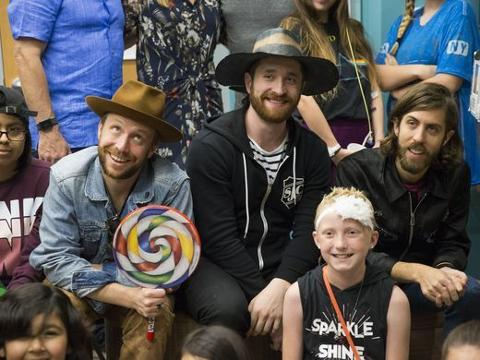 Imagine Dragons rock out with kids at medical center