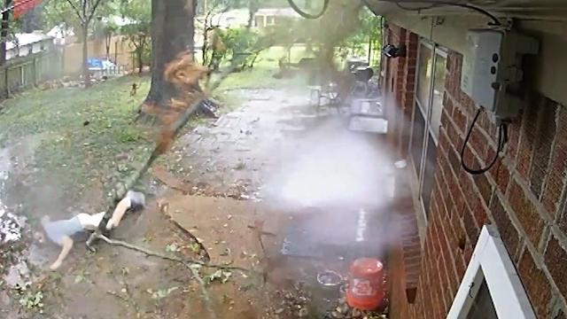 Close call: Man barely escapes huge falling tree branch