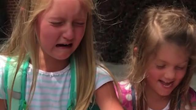 Girls burst into tears of joy when they get a puppy